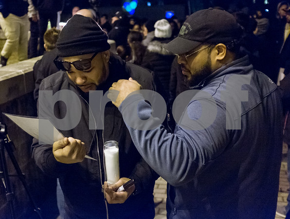 01/26/18 Wesley Bunnell   Staff A candle light vigil was held for 18 year old Moses Negron on Friday evening outside of New Britain High School Satellite Careers Academy where Negron was a student. Negron was one of three killed in a rollover crash on I91 at 7:30am last Sunday morning. Moses Negron fights back tears as he is comforted by his brother Joshua Nieves while looking at a handout of his son, Moses, who was killed in the crash.