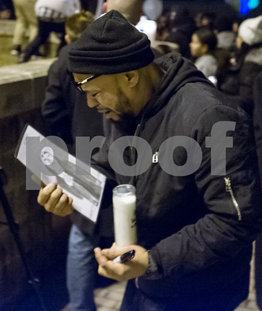 01/26/18 Wesley Bunnell | Staff A candle light vigil was held for 18 year old Moses Negron on Friday evening outside of New Britain High School Satellite Careers Academy where Negron was a student. Negron was one of three killed in a rollover crash on I91 at 7:30am last Sunday morning. Moses Negron fights back tears as looks down at a drawing of his son, Moses, who was killed in the crash.