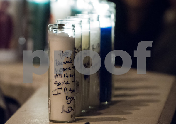 01/26/18 Wesley Bunnell   Staff A candle light vigil was held for 18 year old Moses Negron on Friday evening outside of New Britain High School Satellite Careers Academy where Negron was a student. Negron was one of three killed in a rollover crash on I91 at 7:30am last Sunday morning. Candles with handwritten messages line a back wall of the school.
