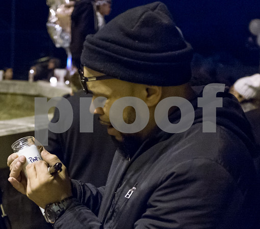 01/26/18 Wesley Bunnell   Staff A candle light vigil was held for 18 year old Moses Negron on Friday evening outside of New Britain High School Satellite Careers Academy where Negron was a student. Negron was one of three killed in a rollover crash on I91 at 7:30am last Sunday morning. Moses Negron fights back tears as he writes a personal message for his son, Moses, on a candle before placing it on a wall where the crowd gathered.