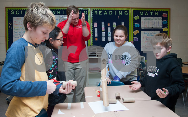 01/29/18 Wesley Bunnell | Staff Mountain View's STEM Lab was visited by a Bristol Eastern science teacher and students on Monday afternoon to work on a science experiment with students from the fifth grade class regarding potential vs kinetic energy. Jaxson Koczur, L, fits pieces together as JeseBelle Arroyo, stands next to Mountain View Teacher Alex Riley, Courtney Haire and Aidan Raboin.