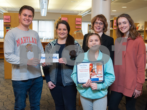 01/29/18 Wesley Bunnell   Staff Aliana Fichera, a 13 year old girl with a life threatening illness CVID, thanked the Bristol Central High School InterAct Club for their donation to the Make A Wish Foundation on Monday afternoon. Aliana recently visited Disney World and other attractions in Central Florida as part of her Make A Wish trip. Jacob Nelson, L, President of Interact, Events Manager for CT Make A Wish Diana Maynard, InterAct Advisor Kelly Monahan-DiNoia, Co-Vice President of Interact Ashley Watson and Aliana Fichera holding the certificate presented to the club.