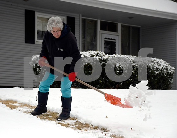 1/30/2018 Mike Orazzi | Staff Nancy Gooneville shovels snow along Castle Road in Bristol Tuesday morning.