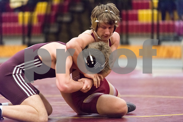 01/31/18 Wesley Bunnell | Staff Sebby Sobieski wrestling in the 170lb match for New Britain vs Farmington on Wednesday evening at New Britain High School.