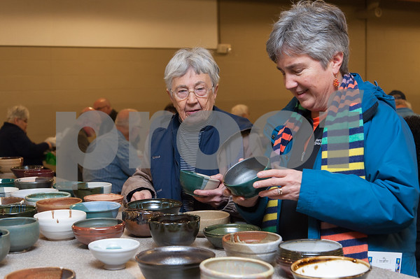 01/31/18 Wesley Bunnell | Staff The Friendship Service Center held their first ever Souper Bowl at E.C. Goodwin on Wednesday evening to raise awareness of hunger and provide funding their soup kitchen. Guests were able to buy a handcrafted ceramic bowl made by Central Connecticut State University art students as the entrance fee and have it filled with the soup of their choice. Students from E.C. Goodwins culinary department handled the serving of the soups. Antoinette Price, L, and daughter Ruth Satterberg look over the bowls available.