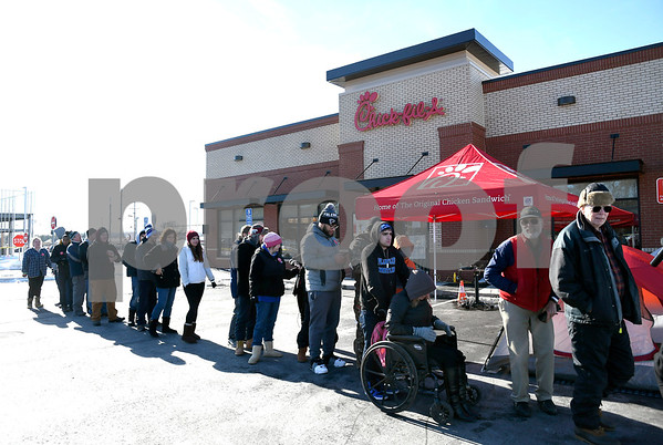 1/10/2018 Mike Orazzi | Staff Bill Manka and Bill Grossberndt with others at Chick-fil-A while in parking outside the new location in Southington the day before opens Wednesday.