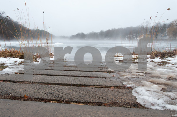01/12/18 Wesley Bunnell | Staff Rain melting ice and fog made for interesting ice designs on Paper Goods Pond in Berlin on Friday afternoon.
