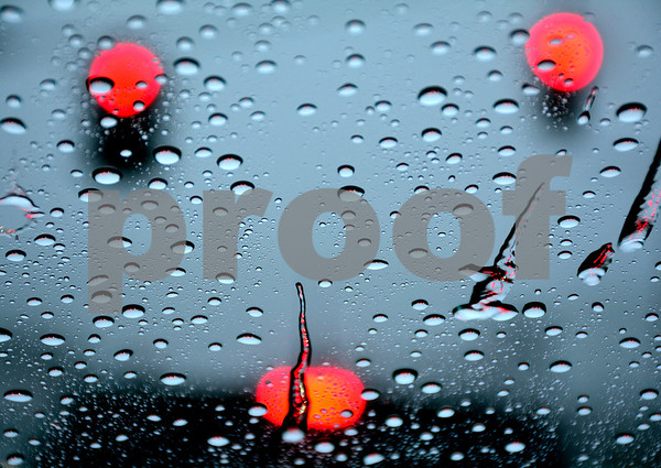 1/12/2018 Mike Orazzi | Staff My rain covered windshield during Friday's rain storm at traffic light in Bristol.