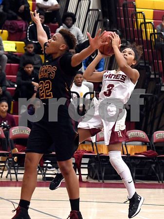 1/13/2018 Mike Orazzi | Staff New Britain's Maya Slisz (3) and Medgar Evers College Preparatory School's Taylir Manhertz (22) in New Britain Saturday afternoon.