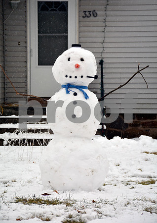 1/17/2018 Mike Orazzi | Staff A snowman along Redstone Hill Road in Bristol during Wednesday's storm.