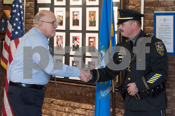 01/17/18 Wesley Bunnell | Staff The Berlin Police Department held a promotion ceremony for two officers on Wednesday evening at town hall. Police Commissioner Chairman Bob Peters shakes hands with new promoted Lieutenant Drew Gallupe.
