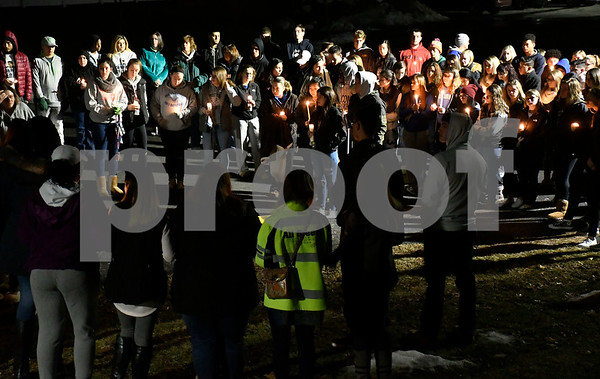 1/27/2018 Mike Orazzi   Staff Friends gather during a vigil at Bristol Eastern High School Saturday night for Kerion Rogers who was killed in a car crash last weekend.