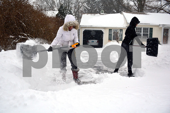 1/4/2018 Mike Orazzi | Staff Yarinet Rodriguez and Maya Martinez clear snow from a driveway along Hoover Avenue in Bristol. during Thursday's snowfall.