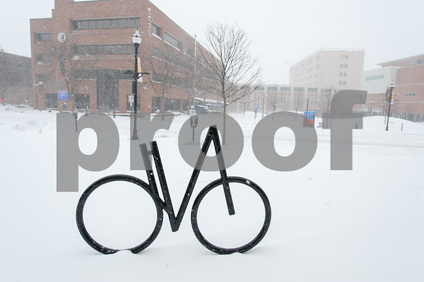 01/04/18 Wesley Bunnell | Staff A blizzard featuring high winds and causing icy conditions hit CT throughout the day on Thursday. A bicycle sculpture on Main St with the CCSU ITBD in the rear.