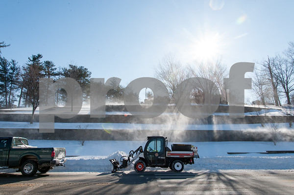 01/05/18 Wesley Bunnell | Staff Swirling winds blow snow drifts on West Main St near Central Park as city workers prepare to work on widening the street on Friday afternoon.