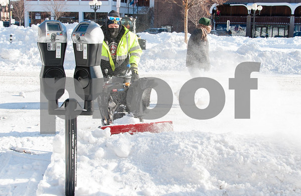 01/05/18 Wesley Bunnell | Staff City workers cleared out Central Park on Friday morning following Thursday's blizzard. Dan Cummings works on clearing up parking around the park.