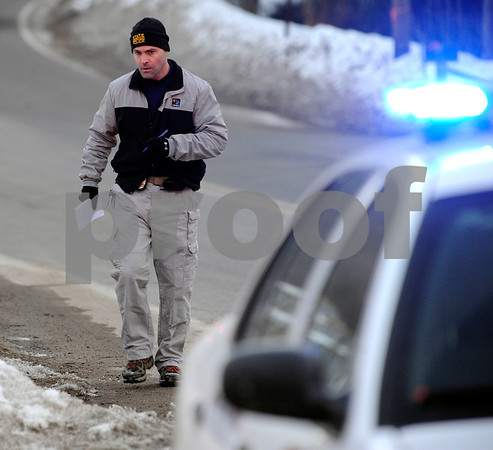 2/23/2011 Mike Orazzi | Staff A Member of the Connecticut State Police on Lane Hill Road while investigating a body found by a hiker at Buttermilk Falls in Plymouth on Wednesday afternoon.