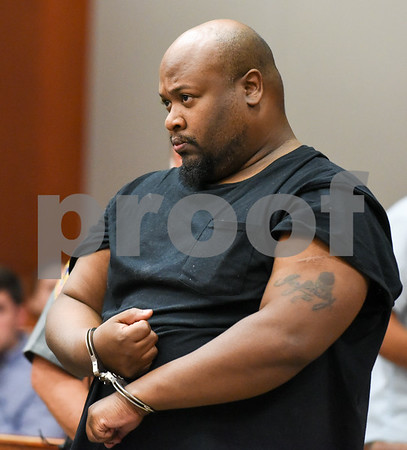 070317 Wesley Bunnell | Staff Colby Boddie stands in New Britain Superior Court on Monday on charges of first-degree assault, second-degree assault with a firearm and criminal use and possession of a firearm.