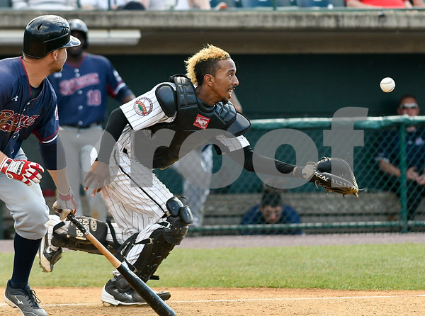 070417 Wesley Bunnell | Staff The New Britain Bees were defeated by the Somerset Patriots on Tuesday afternoon. James Skelton (3) has the ball just out of reach on a pop up bunt attempt.