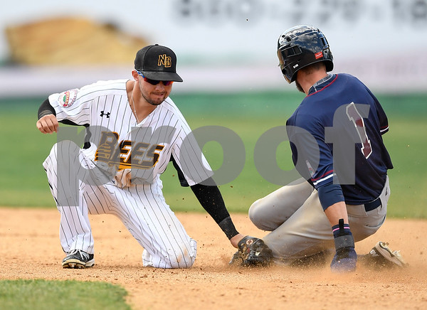 070417 Wesley Bunnell | Staff The New Britain Bees were defeated by the Somerset Patriots on Tuesday afternoon. Michael Baca (5) applies the tag but the runner was ruled safe.