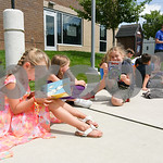 070517  Wesley Bunnell | Staff  Rylee Keeley, age 6, reads One Fish, Two Fish, Three Fish, Blue Fish by Dr. Seuss outside of the Bristol Boys and Girls Club as she sits next to Lyla Bray, ag ...