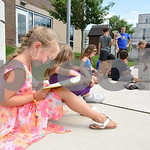 070517  Wesley Bunnell | Staff  Rylee Keeley, age 6, reads One Fish, Two Fish, Three Fish, Blue Fish by Dr. Seuss outside of the Bristol Boys and Girls Club. The books are from the Bristol B ...