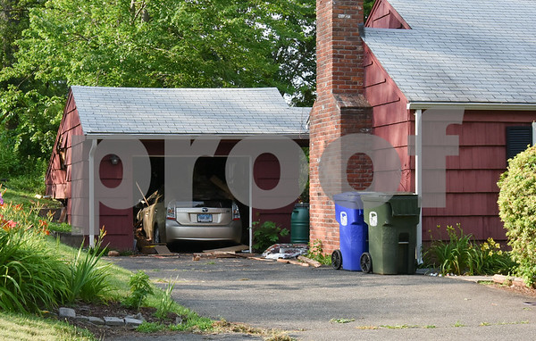 071017 Wesley Bunnell | Staff 124 Indian Hill Rd in Newington where a driver traveling on Oak St veered across the lawn into the side of the garage.