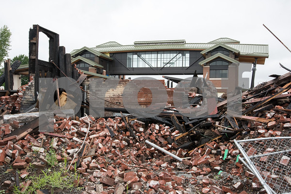071417 Wesley Bunnell | Staff Piles of bricks from the old Berlin Train Station which was destroyed by fire in December 2016 are shown with the new station in the background.