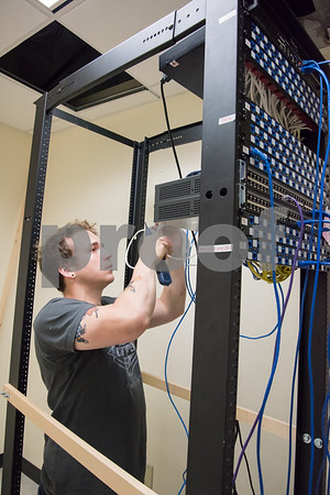 071417 Wesley Bunnell | Staff Adam Sloat from Ed the Phone Guy installs wiring at the New Britain Herald's new location at One Liberty Square.