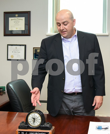 071317 Wesley Bunnell | Staff Incoming President and CEO of Foodshare Jason Jakubowski. Jakubowski discusses the clock given to his grandmother on her retirement from Fafnir Bearings which is featured on his desk.