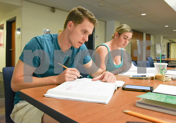 071317 Wesley Bunnell | Staff Erik Kolodziej and Kaitlin Korngiebel study for their Organic Chemistry Class at the CCSU Library on Thursday afternoon.