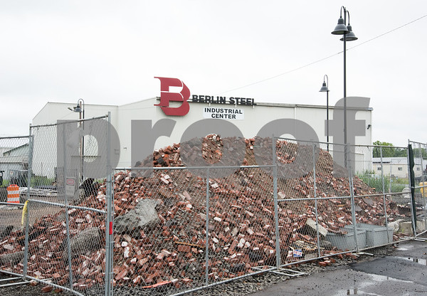 071417 Wesley Bunnell | Staff Berlin Steel's Industrial Center directly next to the Berlin Train Station. The bricks in front are from the old Berlin Train Station that was demolished after a fire in December 2016.