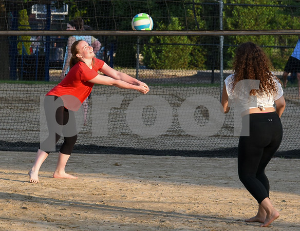 071717 Wesley Bunnell | Staff Shannon McEnerney, L, returns a shot along with teammate Alexandra Rodriguez in a game of sand volleyball at Casey Field in Bristol on Monday evening.