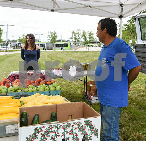 071717 Wesley Bunnell | Staff Monday afternoon marked the first farmers' market of the year at the New Britain Fastrak location with a stand from Dondero Orchards. Amanda Palmisano looks over the selection as Alberto Hernandez of Dondero stands to the right.