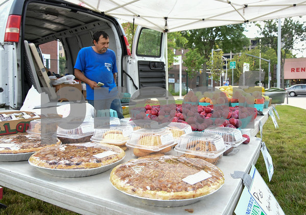 071717 Wesley Bunnell | Staff Monday afternoon marked the first farmers' market of the year at the New Britain Fastrak location with a stand from Dondero Orchards run by Alberto Hernandez.