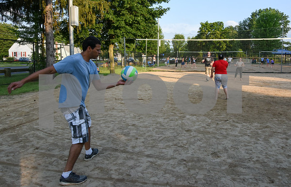 071717 Wesley Bunnell | Staff Carlos Rodriguez prepares to serve in a game of sand volleyball at Casey Field in Bristol on Monday evening.