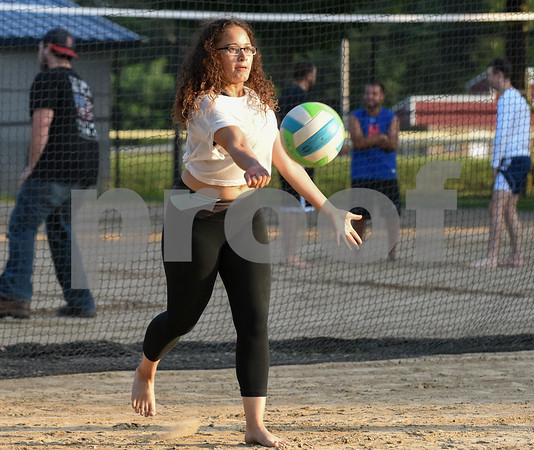 071717 Wesley Bunnell | Staff Enjoying a game of sand volleyball at Casey Field in Bristol on Monday evening is Alexandra Rodriguez.