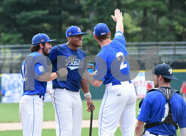 071817 Wesley Bunnell | Staff Jayson Gonzalez (40), middle, of the Bristol Blues gets a pep talk during the home run derby at the FCBL All Star Game at Muzzy Field on Tuesday night. Gonzalez would go on to win the home run derby.