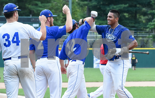 071817 Wesley Bunnell | Staff Jayson Gonzalez (40), R, of the Bristol Blues is congratulated by teammates after winning the home run derby at the FCBL All Star Game at Muzzy Field on Tuesday night.