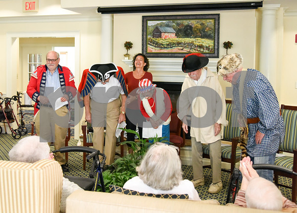 070517 Wesley Bunnell | Staff Residents of Middlewoods of Farmington put on a revolutionary war themed play on July 5th. David Kruh, L, and Cal Kaiser as red coats with Lee Pappas proviiding narration and Bill Raymond and George Byrne as colonists.