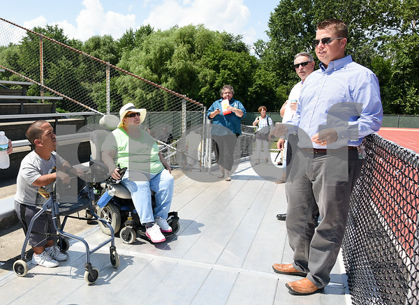 071817 Wesley Bunnell | Staff City officials gave a tour of Veterans' Stadium in New Britain which recently underwent renovations per ADA guidelines. Antonio Orriola, L, and Brenda Socha listen as parks and recreation's Craig Bowman explains improvements made to the grandstand.