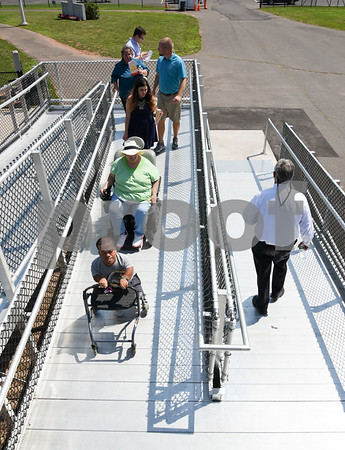 071817 Wesley Bunnell | Staff City officials gave a tour of Veterans' Stadium in New Britain which recently underwent renovations per ADA guidelines. Antonio Orriola, L, and Brenda Socha exit the grandstand via the newly installed ramp.