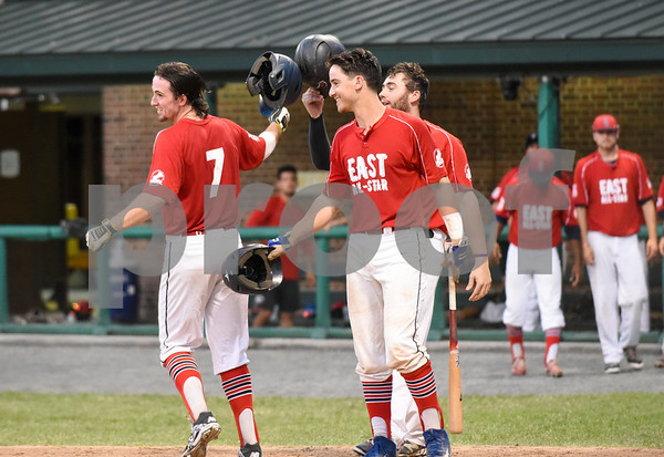 071817 Wesley Bunnell | Staff The FCBL held their All Star Game on Tuesday evening at Muzzy Field which was preceded by a fan fest and workout by players for area scouts. Joe Silva is congratulated by teammates after hitting a two run home run to give the east a 2-0 lead.