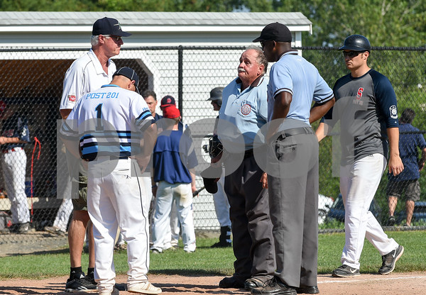 071917 Wesley Bunnell | Staff Southington American Legion Post 72 vs Avon Post 201 on Wednesday afternoon in Avon. The first game was forfeited by Avon after it was ruled they used an ineligible player forcing a second final deciding game. Zone 1 Chairman Tim Vincent, L, informs the coaches and umpires on the ruling.