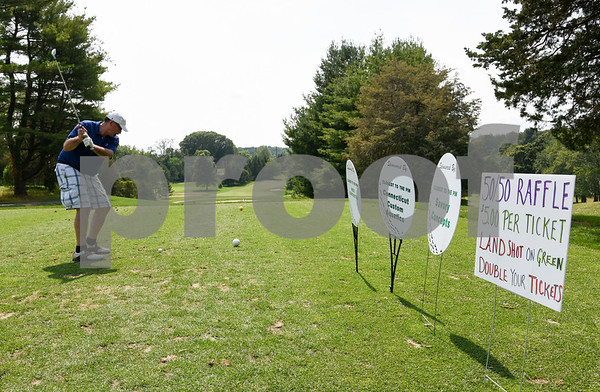 072117 Wesley Bunnell | Staff The Boys and Girls Club of New Britain held the 13th Annual Chuck Roby Golf Tournament, sponsored by Farmington Bank, on Friday at Stanley Golf Course. Ron Albert on the tee.