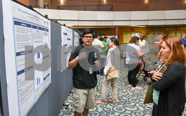 072117 Wesley Bunnell   Staff Middle and High School students completed a two week CCSU TRiO program with presentations and awards on Friday afternoon. Jose E. Garcia explains his research project on alcohol consumption and race.