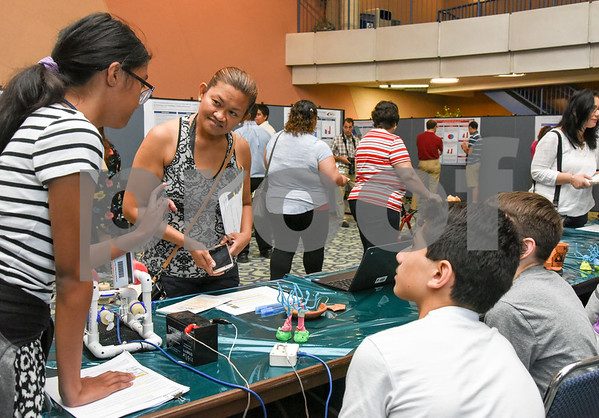 072117 Wesley Bunnell | Staff Middle and High School students completed a two week CCSU TRiO program with presentations and awards on Friday afternoon. Angela Bustamante, L, with project partners Daniel Maroun and Gavin Carter as they explain projects on archeology and deep sea exploration.