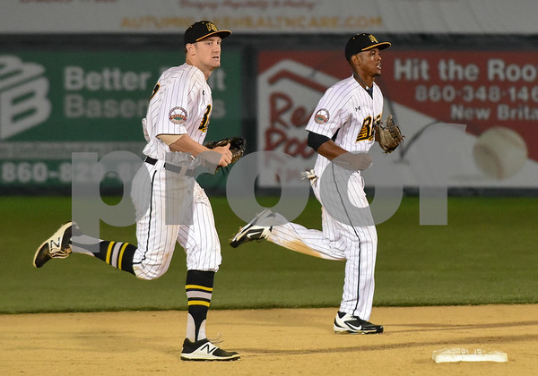072417 Wesley Bunnell | Staff The New Britain Bees lost 2-1 to the Lancaster Barnstormers on Monday evening. Conor Bierfeldt (28), runs off the field with Jordan Hinshaw (19).