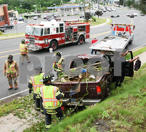 072417 Wesley Bunnell | Staff Emergency crews responded to a pick up truck rollover on Mountain Rd in Bristol on Monday afternoon. A view looking down Mountain Rd.