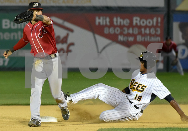 072417 Wesley Bunnell | Staff The New Britain Bees lost 2-1 to the Lancaster Barnstormers on Monday evening. Jordan Hinshaw (19) with a steal of second.